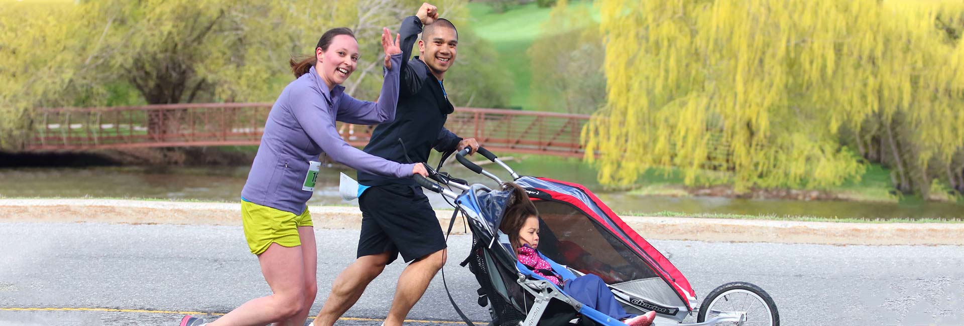 Family jogging with child stroller